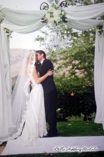 fabric and wrought iron wedding arch