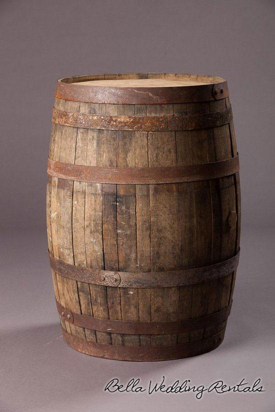 Whiskey barrels wedding decor